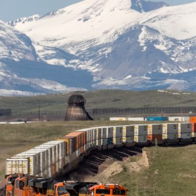 An intermodal train rounds bend outside of Glacier National Park